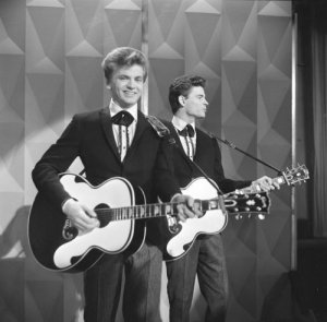 American popular musicians the Everly Brothers, Phil (left) and Don, perform on Ed Sullivan's CBS variety show 'Toast of the Town,' New York, October 29, 1961. (Photo by CBS Photo Archive/Getty Images)
